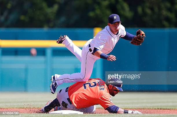 Jose Iglesias of the Detroit Tigers turns the double play forcing our Jonathan Villar of the Houston Astros during the first inning of the game on...