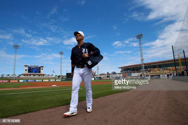 Jose Iglesias of the Detroit Tigers walks to the dugout before the Spring Training game against the Miami Marlins at Joker Marchant Stadium on March...