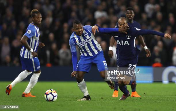 Jose Izquierdo of Brighton and Hove Albion battles for possesion with Lucas Moura of Tottenham Hotspur during the Premier League match between...