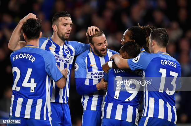 Jose Izquierdo of Brighton and Hove Albion celebrates scoring his side's second goal with team mates during the Premier League match between Brighton...