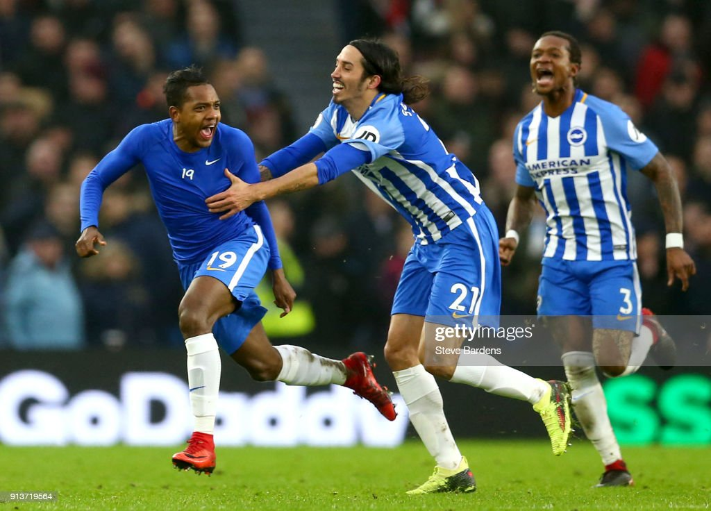 Jose Izquierdo of Brighton and Hove Albion celebrates scoring his side's second goal with Matias Ezequiel Schelotto and Gaetan Bong during the Premier League match between Brighton and Hove Albion and West Ham United at Amex Stadium on February 3, 2018 in Brighton, England.