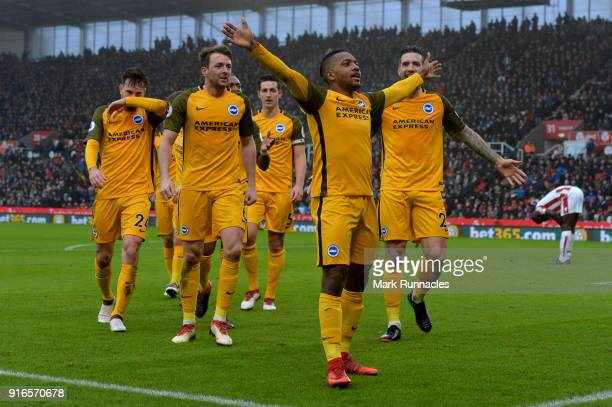 Jose Izquierdo of Brighton and Hove Albion celebrates scoring his side's first goal with team mates during the Premier League match between Stoke...