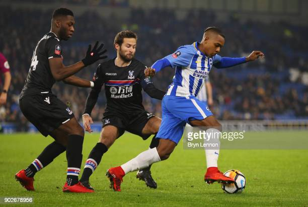 Jose Izquierdo of Brighton and Hove Albion evades Yohan Cabaye and Timothy FosuMensah of Crystal Palace during The Emirates FA Cup Third Round match...