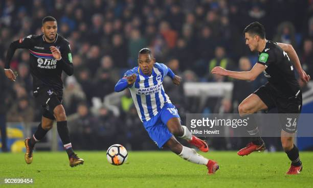 Jose Izquierdo of Brighton and Hove Albion goes between Martin Kelly and Jairo Riedewald of Crystal Palace during The Emirates FA Cup Third Round...
