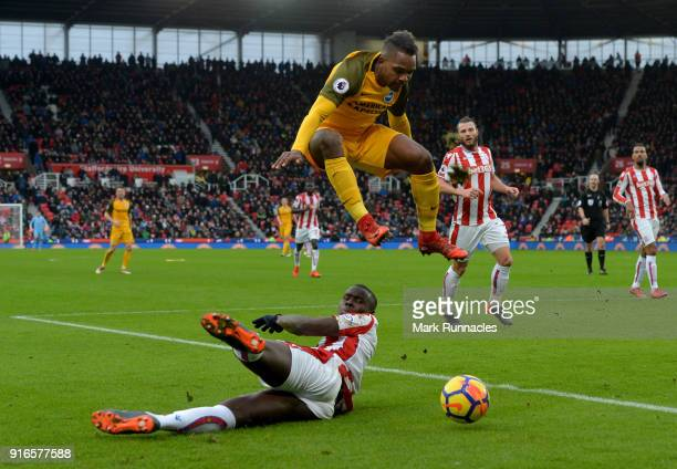 Jose Izquierdo of Brighton and Hove Albion is challenged by Kurt Zouma of Stoke City during the Premier League match between Stoke City and Brighton...