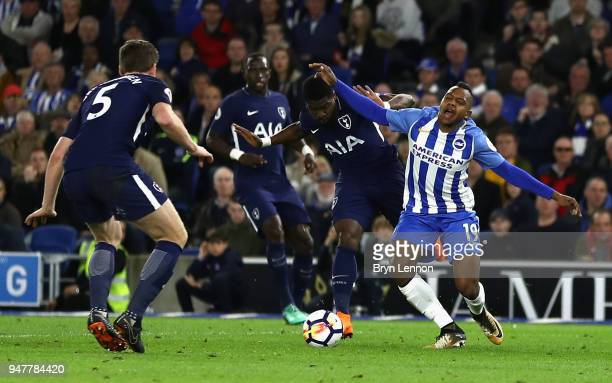 Jose Izquierdo of Brighton and Hove Albion is fouled by Serge Aurier of Tottenham Hotspur which leads to Brighton and Hove Albion being awarded a...