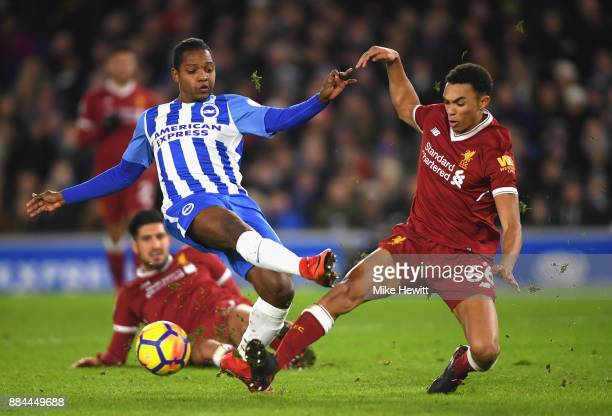 Jose Izquierdo of Brighton and Hove Albion shoots as Trent Alex Arnold of Liverpool attempts to block during the Premier League match between...