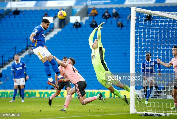 Jose Izquierdo of Brighton & Hove Albion hits the cross bar as Aaron Ramsdale of Sheffield United attempts to save during the Premier League match...