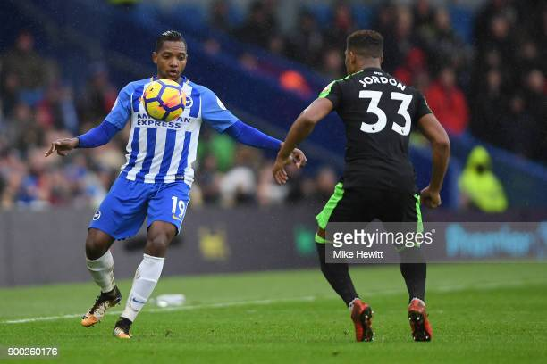 Jose Izquierdo of Brighton is challenged by Jordon Ibe of Bournemouth during the Premier League match between Brighton and Hove Albion and AFC...