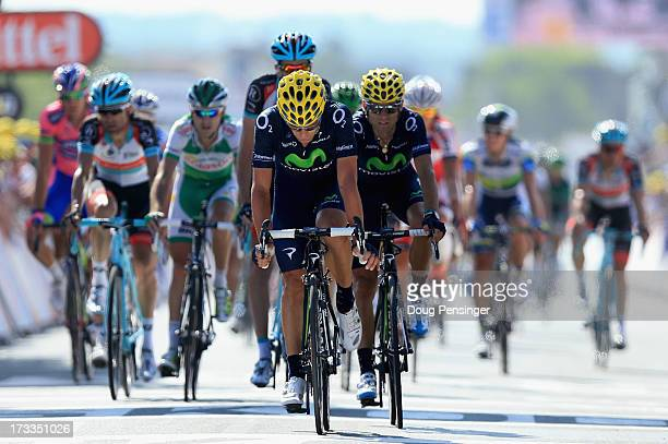 Jose Joaquin Rojas of Spain riding for Team Movistar Team crosses the finish line ahead of his team leader Alejandro Valverde of Spain riding for...