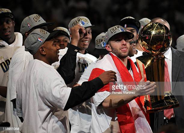 Jose Juan Barea of the Dallas Mavericks celebrates with the Larry O'Brien trophy after the Mavericks won 105-95 against the Miami Heat in Game Six of...