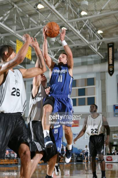 Jose Juan Barea of the Dallas Mavericks drives to the basket against Marcus Williams of the San Antonio Spurs during the Rocky Mountain Review at...