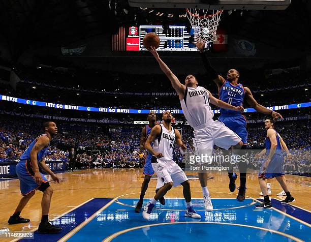 Jose Juan Barea of the Dallas Mavericks goes up for a shot against Russell Westbrook of the Oklahoma City Thunder in the first half in Game Five of...
