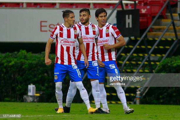 Jose Juan Macias of Chivas celebrates with Carlos Uriel Antuna and Alexis Vega after scoring the first goal of his team during the 9th round match...