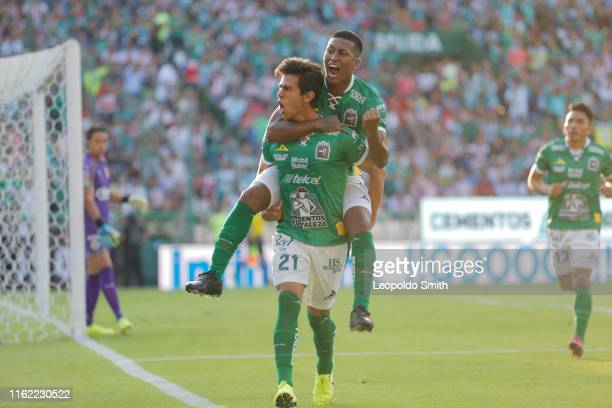 Jose Juan Macias of Leon, celebrates with teammates after scoring the first goal of his team during the 5th round match between Leon and Chivas as...