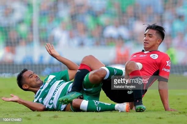 Jose Juan Vasquez of Santos and Michaell Chirinos of Lobos during the 1st round match between Santos Laguna and Lobos BUAP as part of the Torneo...