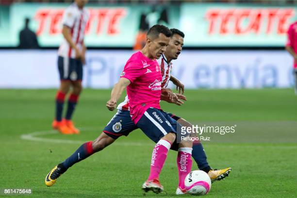 Jose Juan Vazquez of Chivas fights for the ball with Juan Pablo Rodriguez of Morelia during the 13th round match between Chivas and Morelia as part...