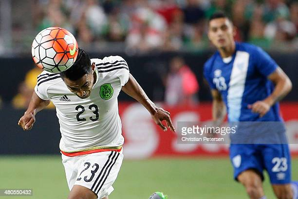 Jose Juan Vazquez of Mexico head passes the ball ahead of Jorge Aparicio of Guatemala during the second half of the 2015 CONCACAF Gold Cup group C...