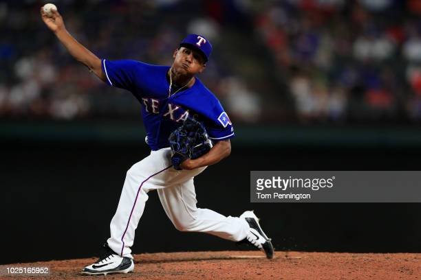 Jose Leclerc of the Texas Rangers pitches against the Los Angeles Dodgers in the top of the ninth inning at Globe Life Park in Arlington on August 29...