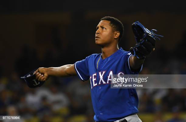 Jose Leclerc of the Texas Rangers reacts as he returns to the dugout after pitching a scoreless seventh inning against the Los Angeles Dodgers at...