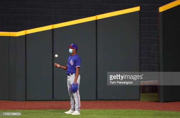 Jose Leclerc of the Texas Rangers stands outside the bull pen during an intrasquad game during Major League Baseball summer workouts at Globe Life...