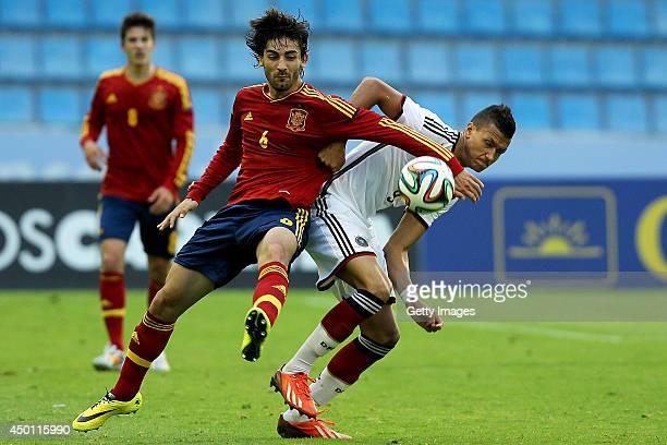 Jose Leon Bernal of Spain challenges Davie Selke of Germany during the UEFA Under 19 Elite Round match between U19 Spain and U19 Germany at Estadio...
