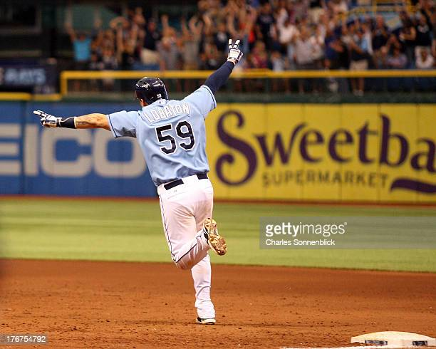 Jose Lobaton of the Tampa Bay Rays celebrates after hitting the winning homerun in the tenth inning against the Toronto Blue Jays during the game on...