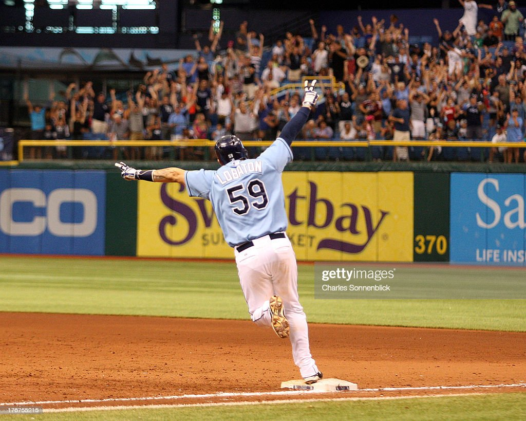 Jose Lobaton #59 of the Tampa Bay Rays celebrates after hitting the winning homerun in the tenth inning against the Toronto Blue Jays during the game on August 18, 2013 at Tropicana Field in St. Petersburg, Florida.