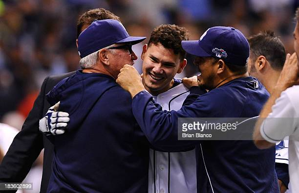 Jose Lobaton of the Tampa Bay Rays is hugged by manager manager Joe Maddon after hitting a walk off home run in the bottom of the ninth inning to...