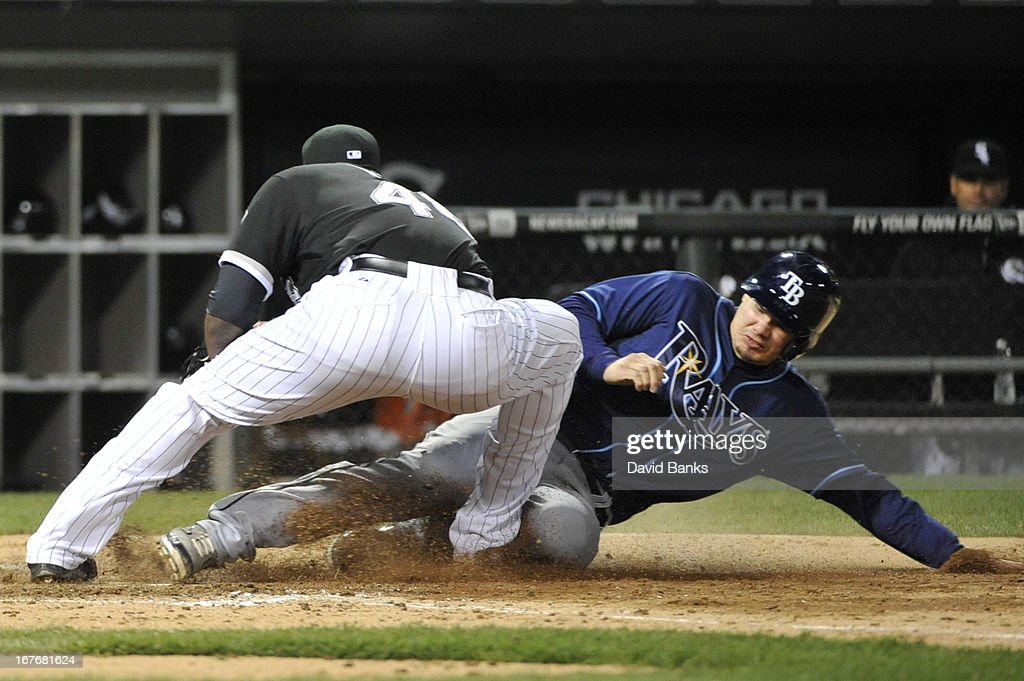 Jose Lobaton #59 of the Tampa Bay Rays scores on a wild pitch as Donnie Veal #46 of the Chicago White Sox makes the tag during the seventh inning on April 27, 2013 at U.S. Cellular Field in Chicago, Illinois.