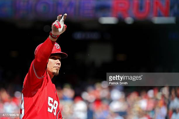 Jose Lobaton of the Washington Nationals celebrates a two run home run in the second inning against the Atlanta Braves at Nationals Park on May 9...