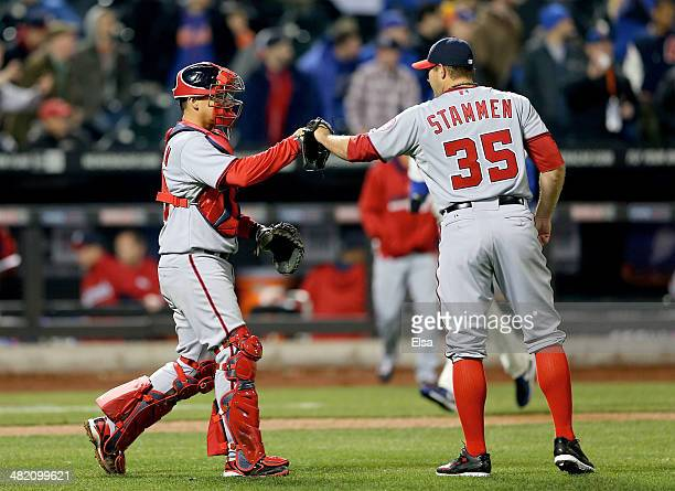 Jose Lobaton of the Washington Nationals celebrates the win with teammate Craig Stammen on April 2, 2013 at Citi Field in the Flushing neighborhood...