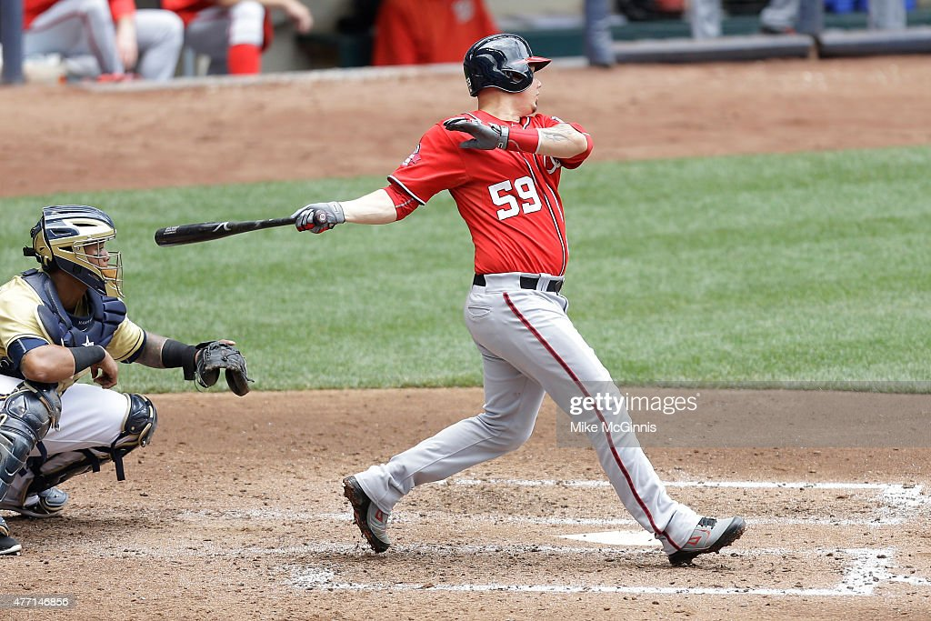 Jose Lobaton #59 of the Washington Nationals hits a RBI single in the fourth inning against the Milwaukee Brewers at Miller Park on June 14, 2015 in Milwaukee, Wisconsin.