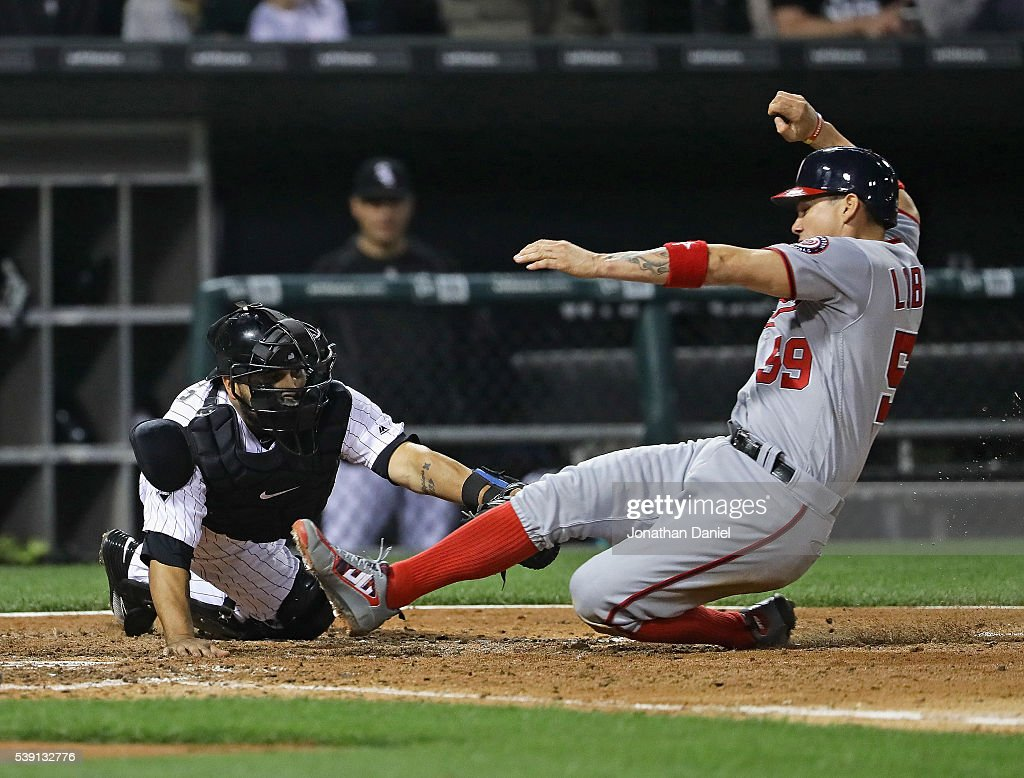 Jose Lobaton #59 of the Washington Nationals is tagged out at the plate by Dioner Navarro #27 of the Chicago White Sox in the 6th inning at U.S. Cellular Field on June 9, 2016 in Chicago, Illinois.