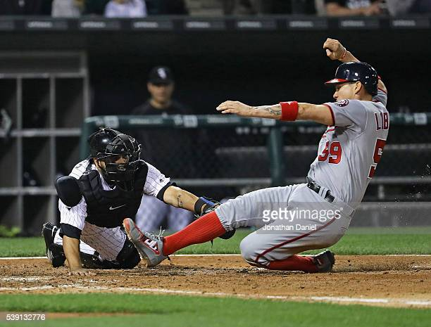 Jose Lobaton of the Washington Nationals is tagged out at the plate by Dioner Navarro of the Chicago White Sox in the 6th inning at US Cellular Field...