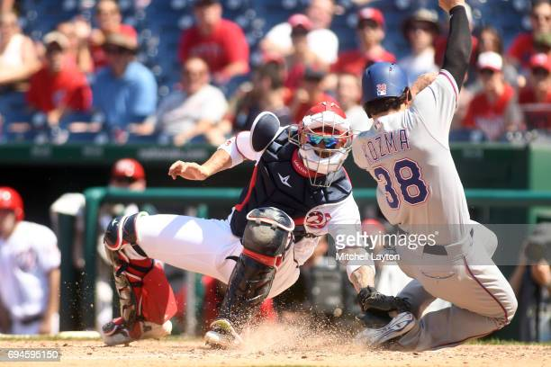 Jose Lobaton of the Washington Nationals tags out Pete Kozma of the Texas Rangers at the plat ein the ninth inning during a baseball game at...