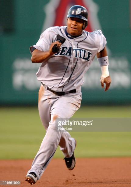 Jose Lopez of the Seattle Mariners sprints toward third base in the first inning of 97 loss to the Los Angeles Angels of Anaheim at Angel Stadium in...