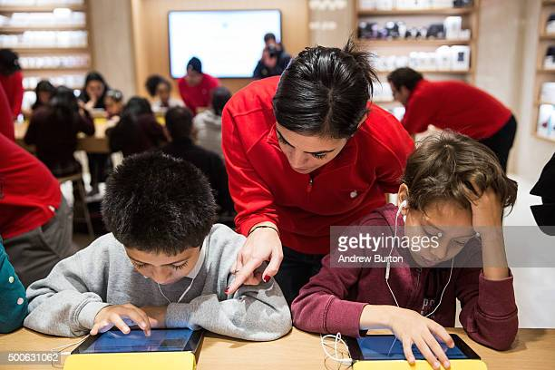 Jose Lucero and Osiel Dominguez third grade students from PS 57 James Weldon Johnson Leadership Academy learn how to code at an Apple Store through...