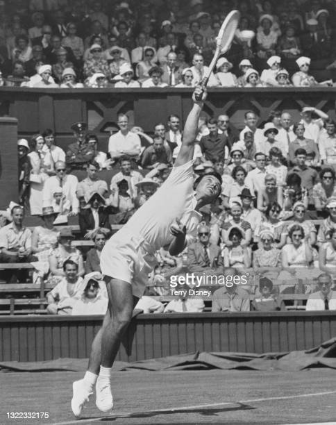 Jose Luis Arilla of Spain serves against Barry MacKay of the United States during their Men's Singles First Round match on Centre Court at the...