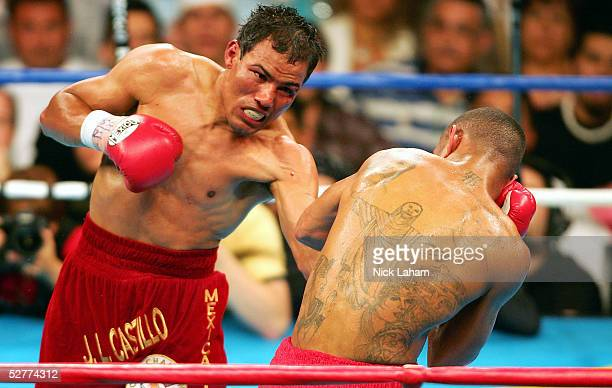 Jose Luis Castillo hits Diego Corrales with a left hook during their World Lightweight Unification bout on May 7 2005 at The Mandalay Bay in Las...