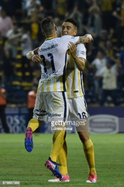 Jose Luis Fernandez and Mauricio Martinez of Rosario Central celebrate after winning a match between Rosario Central and Boca Juniors as part of the...