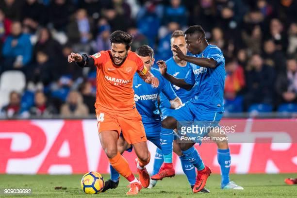 Jose Luis Garcia del Pozo Recio of Malaga CF competes for the ball with Amath Ndiaye Diedhiou of Getafe CF during the La Liga 201718 match between...