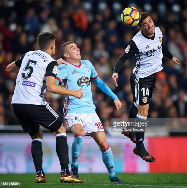 Jose Luis Gaya and Gabriel Paulista of Valencia competes for the ball with Iago Aspas of Celta de Vigo during the La Liga match between Valencia and...