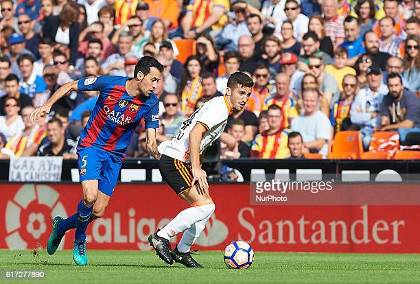 Jose Luis Gaya of Valencia CF and Sergio Busquets of FC Barcelona during the La Liga match between Valencia CF vs FC Barcelona at Mestalla Stadium...