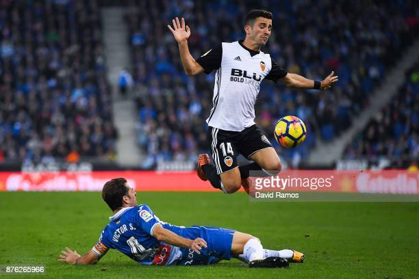 Jose Luis Gaya of Valencia CF competes for the ball with Victor Sanchez of RCD Espanyol during the La Liga match between Espanyol and Valencia at...