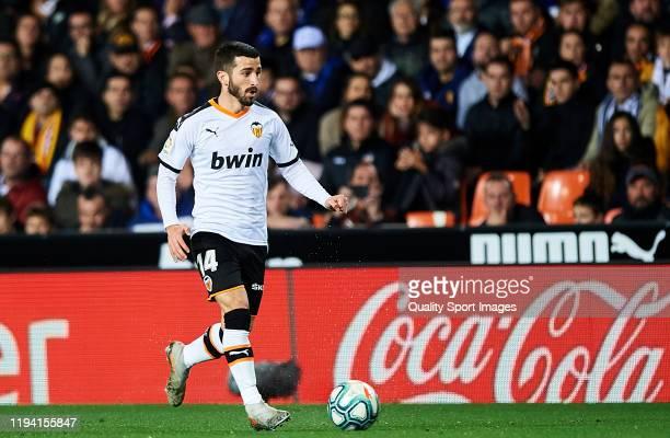Jose Luis Gaya of Valencia CF runs with the ball during the Liga match between Valencia CF and Real Madrid CF at Estadio Mestalla on December 15 2019...