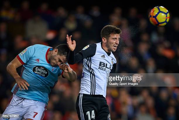 Jose Luis Gaya of Valencia competes for the ball with Maxi Gomez of Celta de Vigo during the La Liga match between Valencia and Celta de Vigo at...