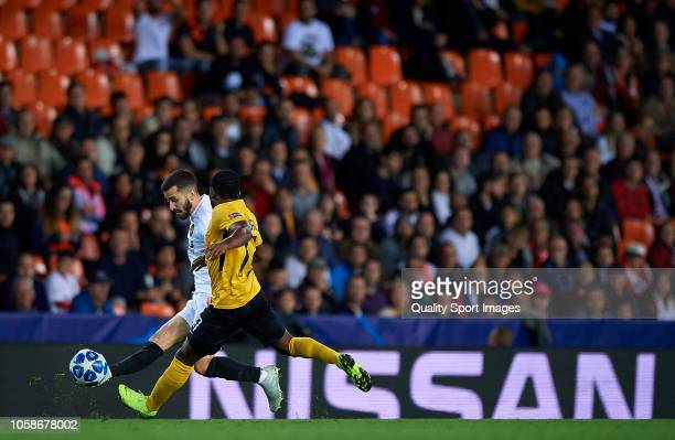 Jose Luis Gaya of Valencia competes for the ball with Roger Assale of Young Boys during the Group H match of the UEFA Champions League between...
