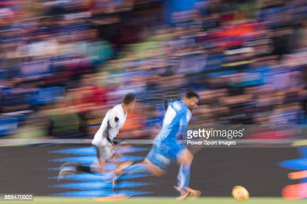 Jose Luis Gaya Pena of Valencia CF in action against Francisco Portillo Soler of Getafe CF during the La Liga 201718 match between Getafe CF and...