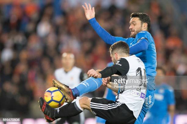 Jose Luis Gaya Pena of Valencia CF in action against Jorge Molina Vidal of Getafe CF during the La Liga 201718 match between Getafe CF and Valencia...